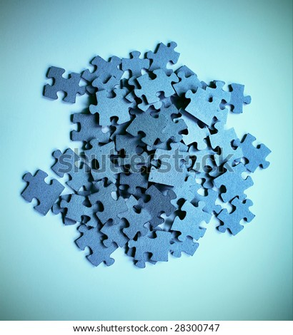Pile of blue puzzle pieces.