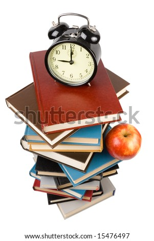 "Pile of books, alarm clock and apple isolated on a white background.  Concept for ""Back to school"""