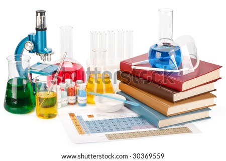 Pile of books, flasks, microscope and magnifier on a white background
