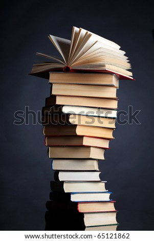 Pile of books on a black background - stock photo