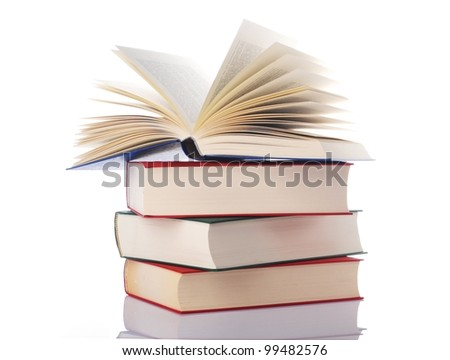 pile of books with one book is open on white background