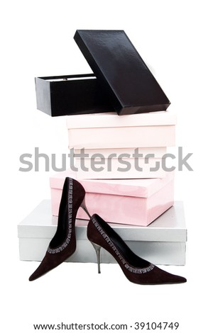 Pile of boxes and brown woman shoes over white