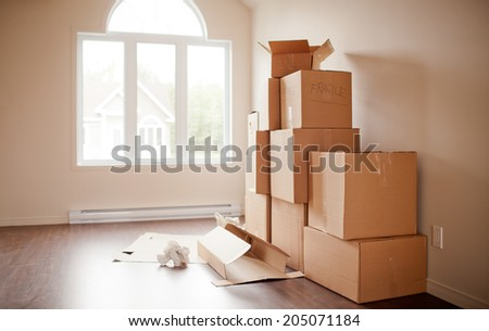 Pile of boxes being opened after moving. Short depth of field in natural light.