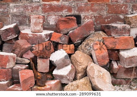 Pile of Bricks by an Old Brick Wall (taken by an old building in Saint John New Brunswick on one of the city streets)