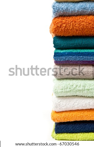 Pile of bright color towels isolated on withe background - stock photo