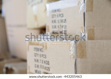 Pile of brown old used cardboard boxes at warehouse of market. Different stuff packed in set of carton boxes ready for delivery, ship insurance, logistics business, garbage utilization concept