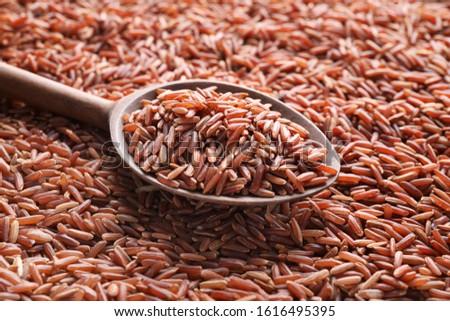 Pile of brown rice with spoon, closeup, closeup