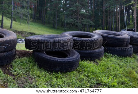 Pile of car  tires on the grass #471764777