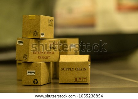 Pile of cardboard boxes products in warehouse. business idea of International freight or shipping service for online shopping or e-commerce concept. freight forwarding goods or services remotely. #1055238854