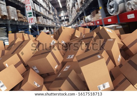 Pile of cartons piled on the ground in a warehouse
