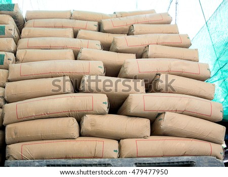 Pile of Cement in bags,neatly stacked for a construction project  #479477950