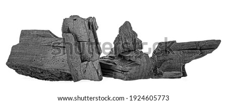 Pile of charcoal isolated on a white background. Natural wood charcoal. Hard wood charcoal. Сток-фото ©