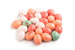 Pile of chocolate eggs candies isolated on white background. close up, side view, macro.