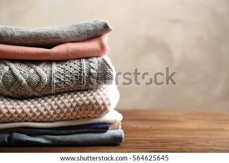 Pile of clothes on table