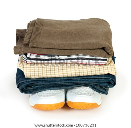 pile of clothes on the  shoes isolated white background