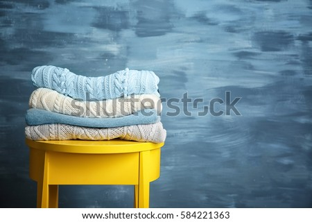 Pile of clothes on wooden stool