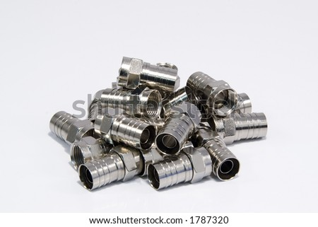 pile of Coax Silver connector on white background