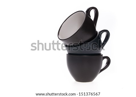 Pile of coffee cups on isolated white