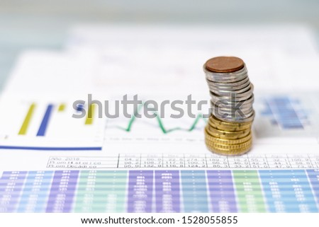 Pile of coins on statistical diagrams
