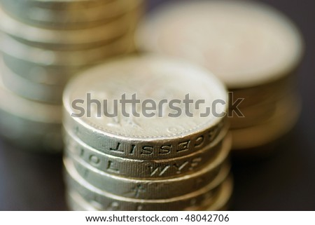Pile of coins with shallow depth of field