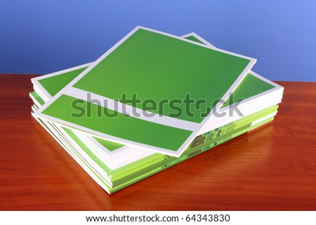 Pile of color magazines  on blue background