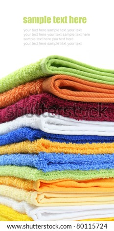 Pile of colorful bath or spa towels isolated with copyspace