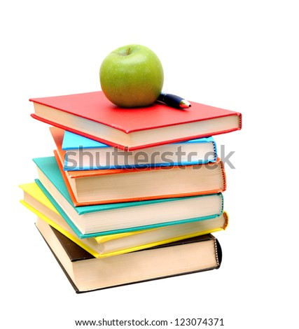 pile of colorful books and apple isolated on white background