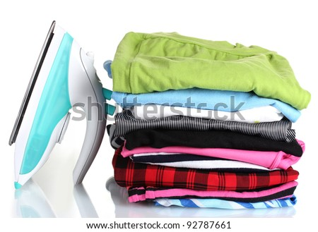 Pile of colorful clothes and electric iron isolated on white #92787661