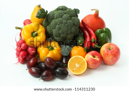 Pile of colorful fruits and veggies on isolated background - stock photo