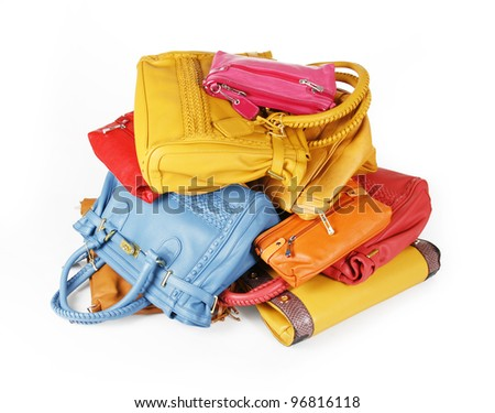 pile of colorful handbags isolated on white