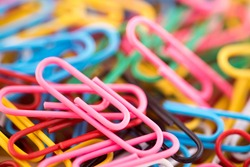 Pile of colorful paper clips macro abstract background