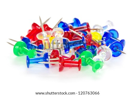Pile of colorful pushpins on a white background