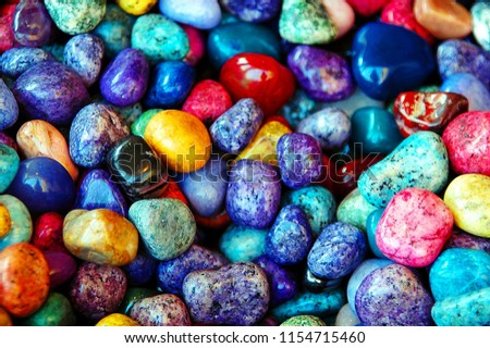 Pile of colorful Sea Pebble stones and rocks on beach.Different forms multicolor Pebbles (orange,white,yellow,blue,green,red) as natural abstract texture background.Close up colourful Pebbles on coast - Shutterstock ID 1154715460