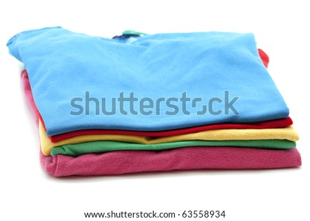 pile of colorful T-shirts isolated on white