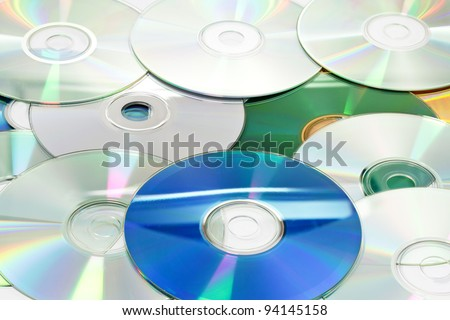 Pile of Compact Discs (CDs) on white background