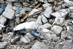 Pile of concrete debris at a building demolition site.