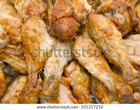 Pile of cooked chicken drumsticks