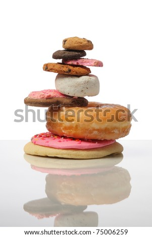 pile of cookies and donuts cutout on white background