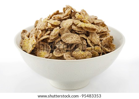 Pile of corn flakes in cup.