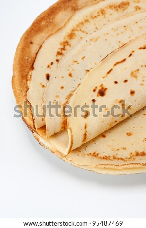 Pile of crepes on plate, close-up