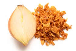 Pile of crispy fried onions next to half of fresh onion isolated on white. Top view.