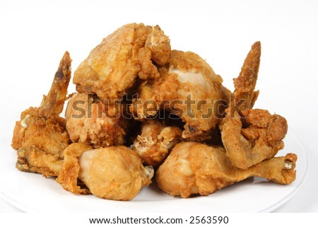 Pile of Crispy Golden brown fried chicken on a white background.