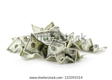 Pile of crumpled money dollar bills overs white background