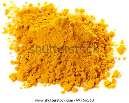 Pile of curry powder isolated on white