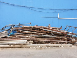 Pile of damaged building materials placed along the wall