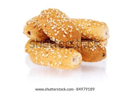 Pile of delicious cookies over white background