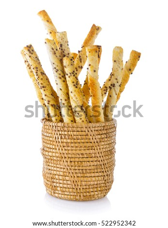 pile of delicious pretzel sticks in basket isolated on white background #522952342