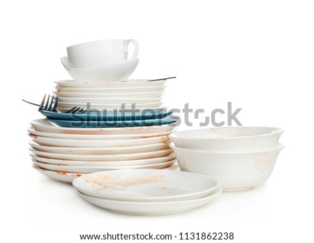 Pile of dirty kitchenware on white background