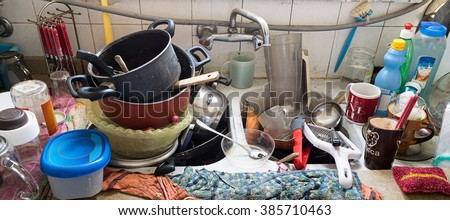 Pile of dirty utensils in a kitchen washbasin Stock foto ©