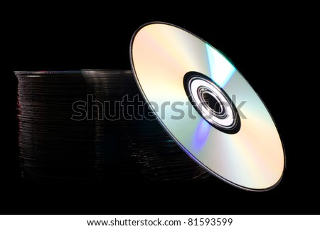 Pile of disks with colorful light reflection